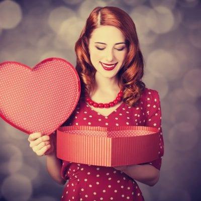 Woman holding valentines present